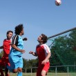 Stock Photo: Footballer heading ball towards goal