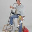 Carpenter stood by ladder giving the thumbs-up — Stock Photo #14245939