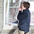 Man placing a window — Stock Photo #14246135