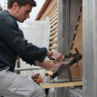 Stock Photo: Roofer adjusting slate tile