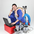 Stock Photo: Labourer surrounded by tools and equipment