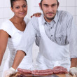 Couple working in a butchers - Stock Photo
