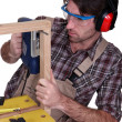 Man building a wooden frame — Stock Photo #14249871