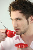 Man with red coffee cup — Stock Photo
