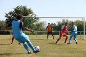 Footballer going for goal — Stock Photo