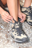 Close-up of a woman doing up her shoelaces — Stock Photo