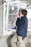 Man placing a window — Stock Photo