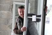 Manual worker holding window — Stock Photo