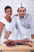 Couple working in a butchers — Stock Photo