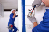 Craftsman working on the electricity installation — Stock Photo