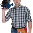 Stock Photo: Mholding circular saw