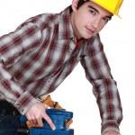 A trainee handling a jigsaw. — Stock Photo