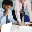 Workers in architect office - Stock Photo