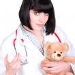 Nurse making an injection to a teddy bear — Stock Photo #14254301