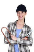 Female plumber with tools — Stock Photo