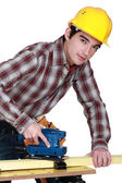 A trainee handling a jigsaw. — Stock Photo