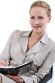 Professional blonde woman with a personal organizer — Stock Photo