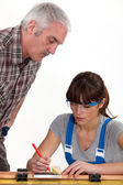 Man supervising his assistant — Stock Photo