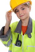 Schoolgirl dressed as foreman — Stock Photo