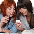 Two female friends procrastinating their studies. — Stock Photo