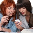 Royalty-Free Stock Photo: Two female friends procrastinating their studies.