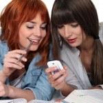 Two female friends procrastinating their studies. — Stock Photo #14264001