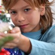 Boy decorating a Christmas tree — Stock Photo #14264375