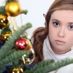 Woman posing next to a Christmas tree — Stock Photo #14264625