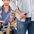 A singer and a drummer — Stock Photo