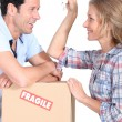 Stock Photo: Couple moving into their new home