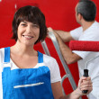 Couple painting wall in red — Stock Photo #14269951