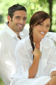 Couple in white with matching smiles — Stock Photo