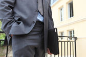 Businessman carrying his portfolio — Stock Photo