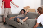 Three lads moving into their new home — Stock Photo
