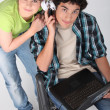 Teenagers listening to music on a laptop Dufour_Quentin_140410;Godreau_Lea_140410 — Stock Photo