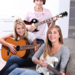 Teen playing guitar — Stock Photo #14270467