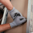 Pair of hands fixing something behind wall — Stock Photo #14270895