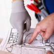 Stock Photo: Workers pointing at building layout
