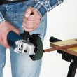 Man holding a grinding machine. — Stock Photo #14271223