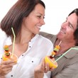 Couple enjoying a fruit salad — Stock Photo