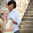 Couple by stone steps — Stock Photo #14271409