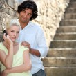 Stock Photo: Couple by stone steps