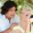 Young woman with binoculars and boyfriend — Stock Photo