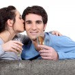 Couple with champagne glasses kissing — Stock Photo #14271787