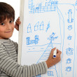 Boy drawing on a whiteboard — Stock Photo
