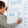 Foto de Stock  : Boy drawing on whiteboard