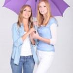 Girls under a purple umbrella — Stock Photo