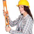 Craftswoman holding a level — Stock Photo