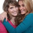Stock Photo: Two female friends hugging.