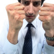 Businessman clenching his fists — Stock Photo